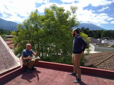 Dan and our housemate Brent chatting on the school roof during a break